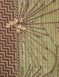 Painted kākaho (toetoe stems) held together by kiekie in tukutuku panel, Te Aitanga ā Tāne, created by Mae Taurua. In Allan Herbarium, Manaaki Whenua, Lincoln, New Zealand (Photograph: Sue Scheele)